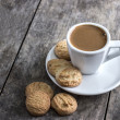 Coffee cup and cookies on table — Stock Photo #23457818