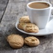 Stock Photo: Coffee cup and cookies on table