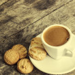Stock Photo: Coffee and cookies on table