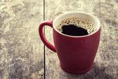 Old red coffee mug — Stock Photo