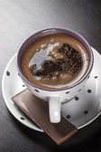 Coffee cup and chocolate — Stock Photo