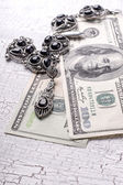 Old necklaces and money — Stock Photo