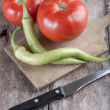Tomatoes and hot peppers — Stock Photo #26927791
