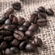 Coffee beans on canvas — Stock Photo