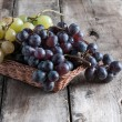 Grapes on a old wooden table — Stock Photo