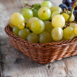 Stock Photo: Grapes on old wooden table