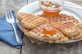 Breakfast with waffles and jam — Stock Photo