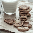 Stack of Chocolate chip cookie and glass of milk — Stock Photo