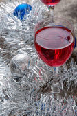 Two glasses of Red Wine and Christmas Ornaments — Stock Photo