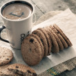 Cookies and coffee on table — Stock Photo