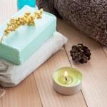 Bar of natural handmade soap and towel — Stock Photo