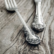 Old cutlery on wooden table — Stock Photo #39391811