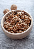 Walnuts in wooden bowl — Stock Photo