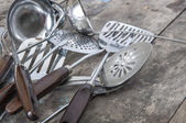 Old Vintage Metal soup ladles and slotted spoon — Stock Photo