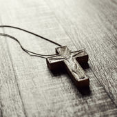 Wooden cross on a wooden surface — Stock Photo