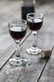 Glass of cherry liqueur on wooden table — Stock Photo