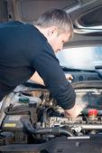 Young man fixing his car — Stock Photo
