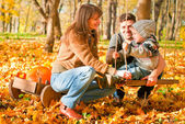 Happy family relaxing outdoors — Stock Photo