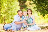 Happy Family Having a Picnic In Summer Park — Stock Photo