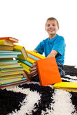 Boy holds pile of books — Stock Photo