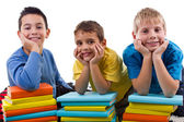 Boys with piles of books — Stock Photo