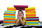 Smiling boy with stack of books — Stock Photo