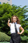 Young businesswoman giving a thumbs up — Stock Photo