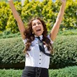 Happy business woman with arms outstretched — Stock Photo #27260023
