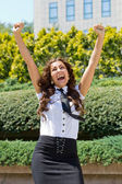 Happy business woman with arms outstretched — Stock Photo