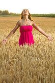 Beautiful woman enjoy in field of wheat — Stock Photo
