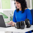 Stock Photo: Professional photographer working from home