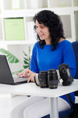 Professional photographer working from home — Stock Photo