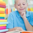 Young boy learns from books — Foto de Stock
