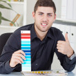 Stock Photo: Successful businessmshowing color palettes