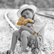 Runaway child on railroad hugging his teddy bear — Stock Photo