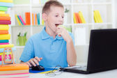 Young boy eating a green apple and study — Stock Photo