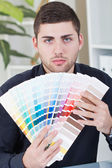Young successful businessman showing color palettes — Stock Photo
