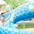 Child in aquapark  having fun — Stock Photo