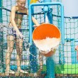 Stock Photo: Little boy having fun in aqua park