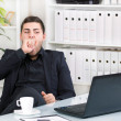 Bored businessman in the office — Stock Photo