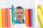 Boy in the library — Stockfoto
