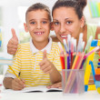 Smiling mother helping son to do his homework — Stock Photo #31280365