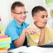 Two young boys looking at the laptop — Stock Photo