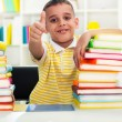 School boy with thumb up — Stock Photo