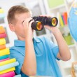 Boy using binoculars — Stock Photo