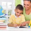 Smiling mother and son studying — Stockfoto