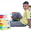 Schoolboy sitting on the flor — Stock Photo