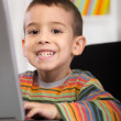 Funny little boy with  laptop  — Stock Photo