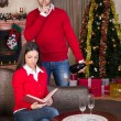 Man surprising woman on Christmas evening — Stock Photo
