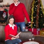 Man surprising woman on Christmas evening — Stock Photo #32557537